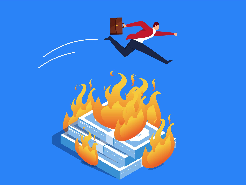 Homme d'affaires qui saute au-dessus de billets en feu